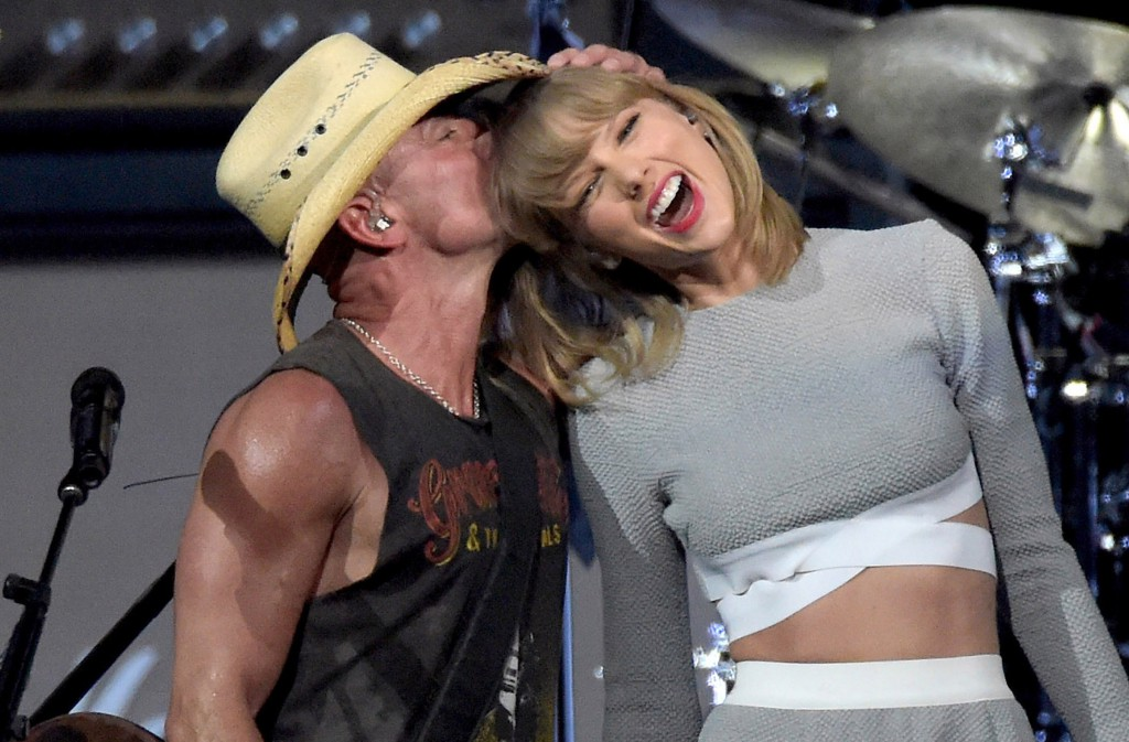 NASHVILLE, TN - MARCH 26:  (EXCLUSIVE ACCESS, SPECIAL RATES APPLY) Kenny Chesney and Taylor Swift perform onstage during Kenny Chesney's The Big Revival 2015 Tour kick-off for a 55 show run through August. The high-energy opening night included 2½ hours of music, including five songs from his #1 The Big Revival, surprise guests and a leaner, cleaner stage and 2.3 million pixel screen that gave the sold out house the best view theyve ever had of the 8-time Entertainer of the Year at the Bridgestone Arena on March 26, 2015 in Nashville, Tennessee  (Photo by Rick Diamond/Getty Images for Kenny Chesney)