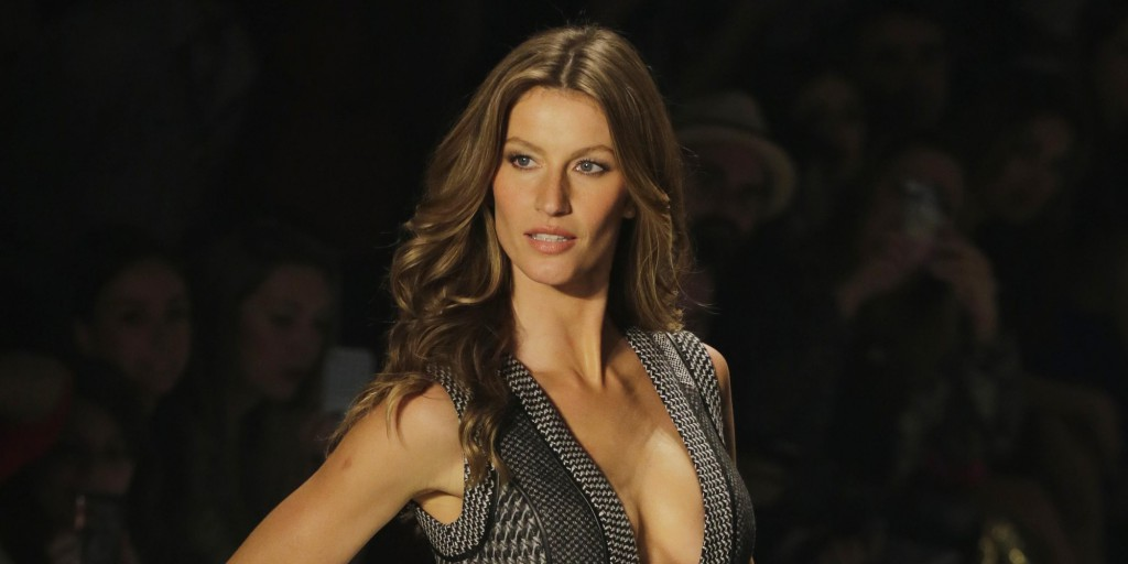Brazilian top model Gisele Bundchen wears a creation from Colcci winter collection during the Sao Paulo Fashion Week in Sao Paulo, Brazil, Thursday, Oct. 31, 2013. (AP Photo/Nelson Antoine)