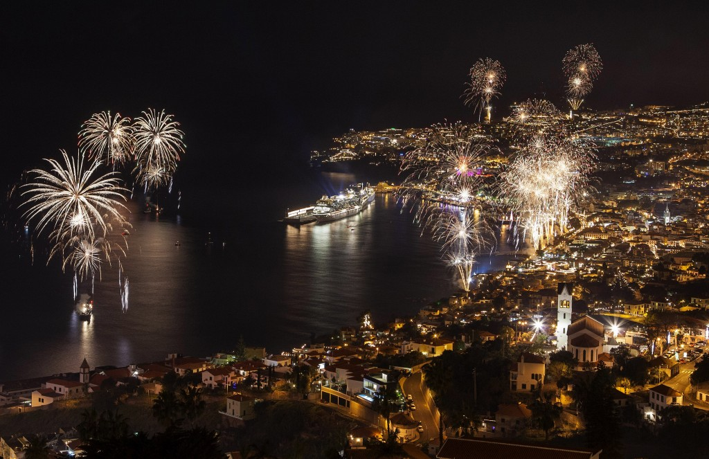 Fireworks light up the sky above Funchal Bay, Madeira Island, to celebrate the arrival of the New Year on January 1, 2013.  World cities from Sydney to Dubai rang in the  New Year with a spectacular global wave of firework displays.     AFP PHOTO / GREGORIO CUNHAGREGORIO CUNHA/AFP/Getty Images