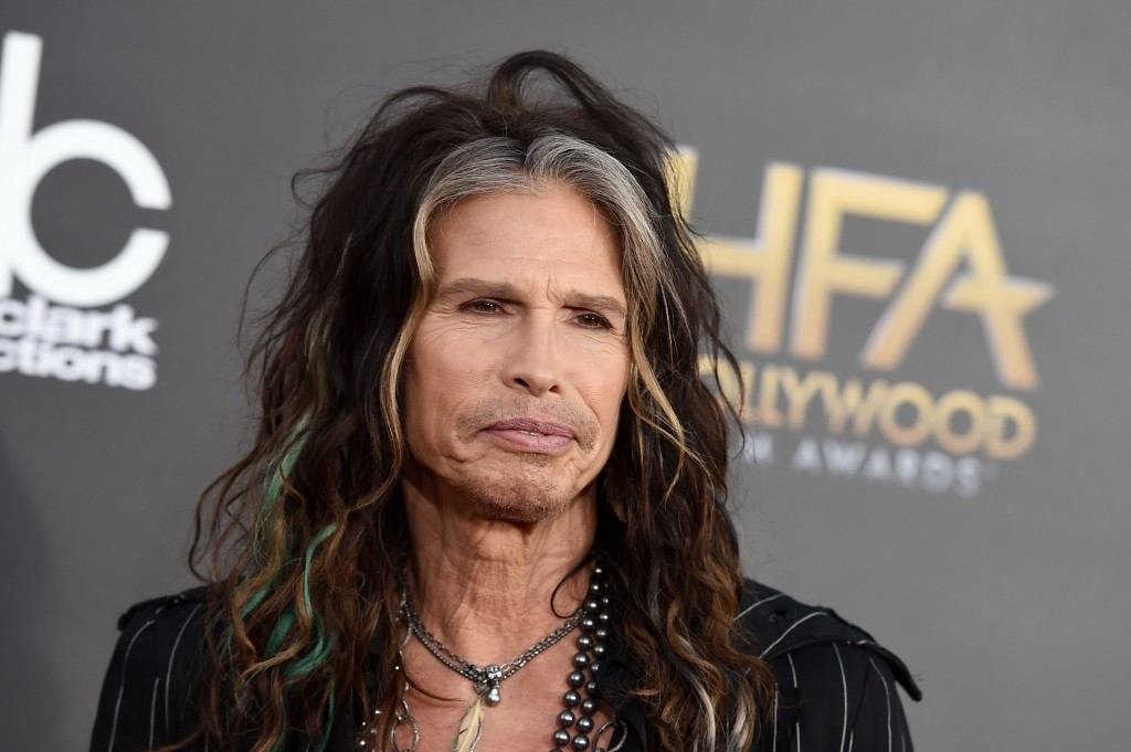 FILE - In this Friday, Nov. 14, 2014, file photo, Steven Tyler arrives at the Hollywood Film Awards at the Palladium, in Los Angeles. Tyler and Charlie XCX headlined the Rolling Stone Super Bowl party on Saturday, Jan. 31, 2015. (Photo by Jordan Strauss/Invision/AP, File)