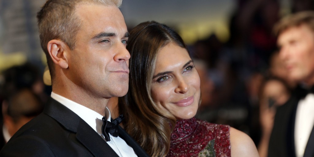 Robbie Williams and Ayda Field pose for photographers upon arrival for the screening of the film The Sea of Trees at the 68th international film festival, Cannes, southern France, Saturday, May 16, 2015. (Photo by Joel Ryan/Invision/AP)